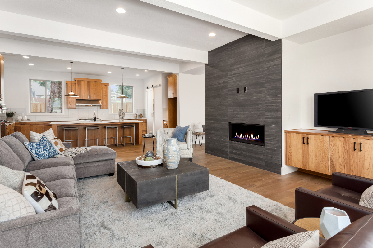 living room with fireplace and large overhead shelf