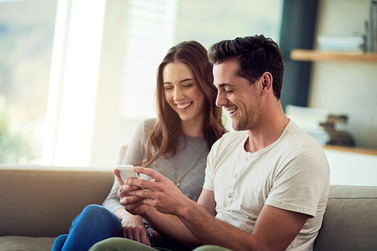 couple looking at laptop computer